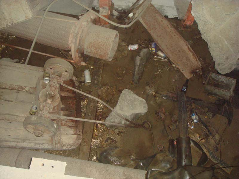 A trench full of junk - that pipe you see at the upper left is 16 inches in diameter by the way.