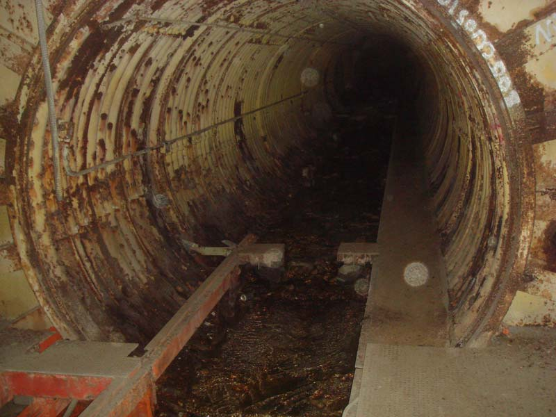 Looking down the launcher tunnel toward the fuel terminal: Somewhere up ahead lay the headwaters of mighty Titan Creek