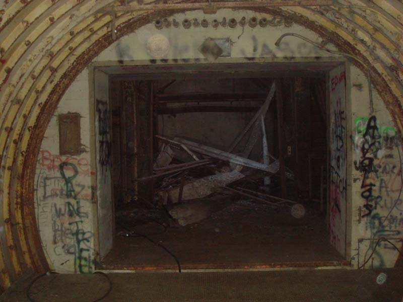 Looking into the entry portal.  The pile of junk is where the elevator was once located.